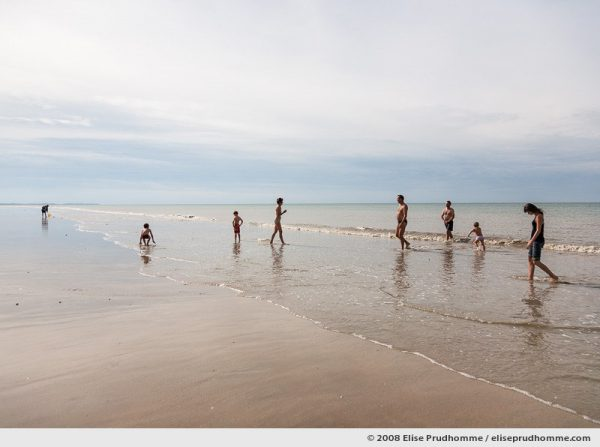 A family of September bathers at low-tide, Hauteville-sur-Mer, France, 2008 by Elise Prudhomme