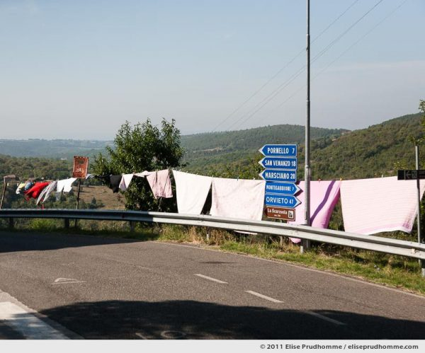 Laundry hung to dry along the roadside, Montegiove, Italy, 2011 by Elise Prudhomme