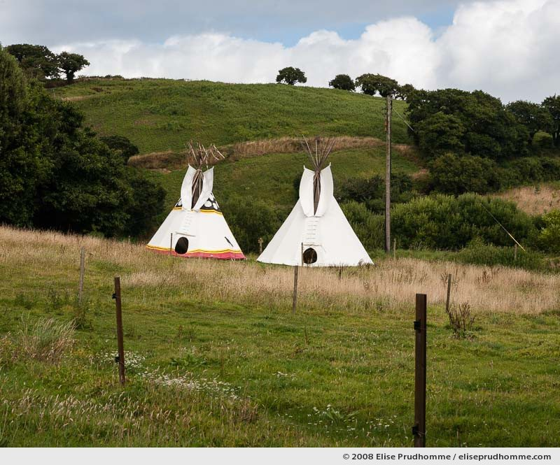 Nostalgic wilderness campsite and two teepees, Jersey, Channel Islands, 2008 by Elise Prudhomme.