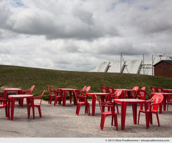 "Red plastic tables and chairs ""Miko"" at a seaside cafe, Tourlaville, France, 2013 by Elise Prudhomme"