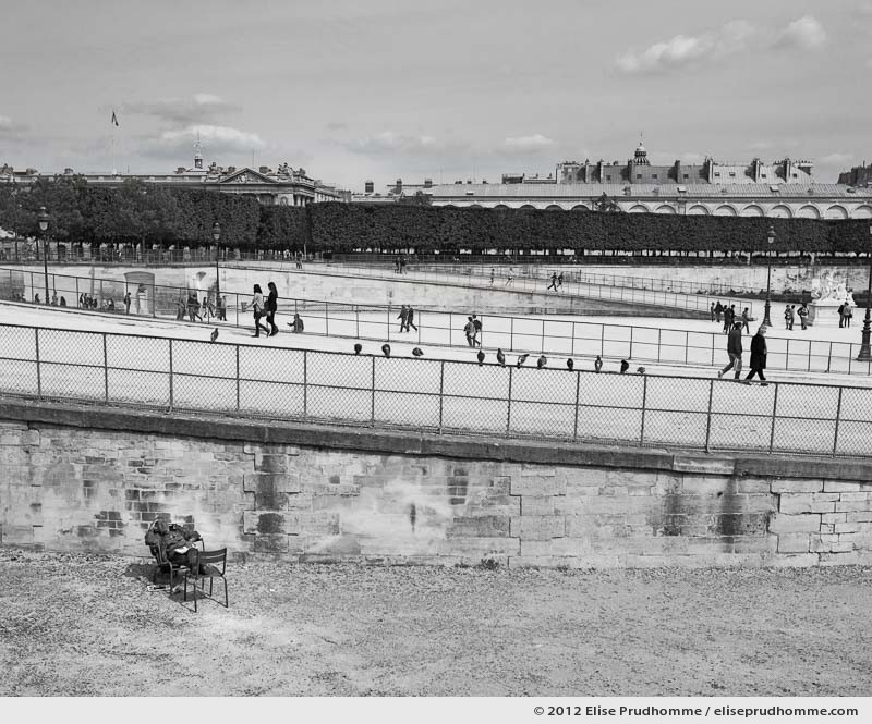 Pause, Tuileries Garden, Paris, France, 2012 (part of the series Yours, Mine, Le Nôtre's) by Elise Prudhomme.