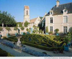 Late afternoon view of the church and château from the first terrace, Brécy Castle Gardens, Saint Gabriel Brécy, France, 2012 (series Notable Gardens of France) by Elise Prudhomme.