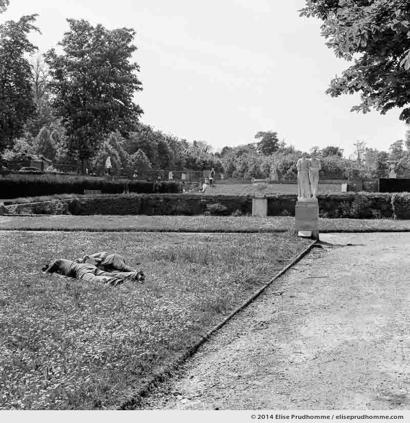 Napping in the Allée des Statues, Saint-Cloud Park, France (series Yours, Mine, Le Nôtre's) by Elise Prudhomme.