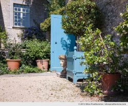 Garden sculpture and door detail, Brecy Castle Gardens, Saint Gabriel Brécy, France, 2012 (series Notable Gardens of France) by Elise Prudhomme.