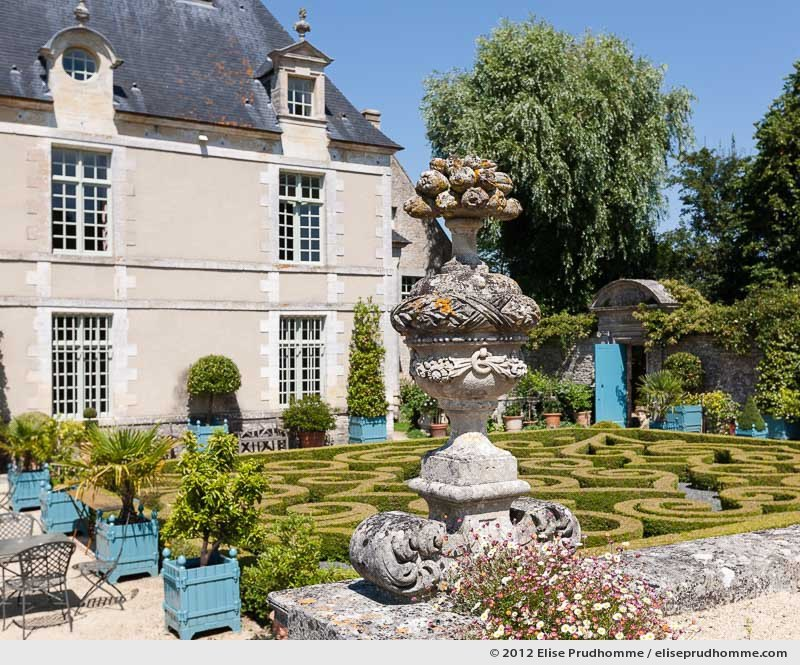 View of the boxwood parterre and château from the first terrace, Brecy Castle Gardens, Saint Gabriel Brécy, France, 2012 (series Notable Gardens of France) by Elise Prudhomme.