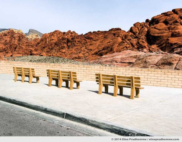Benches and seating area at a scenic viewpoint in Red Rock Canyon National Conservation Area, Nevada, USA. 2014 (series Wild Wild West) by Elise Prudhomme.