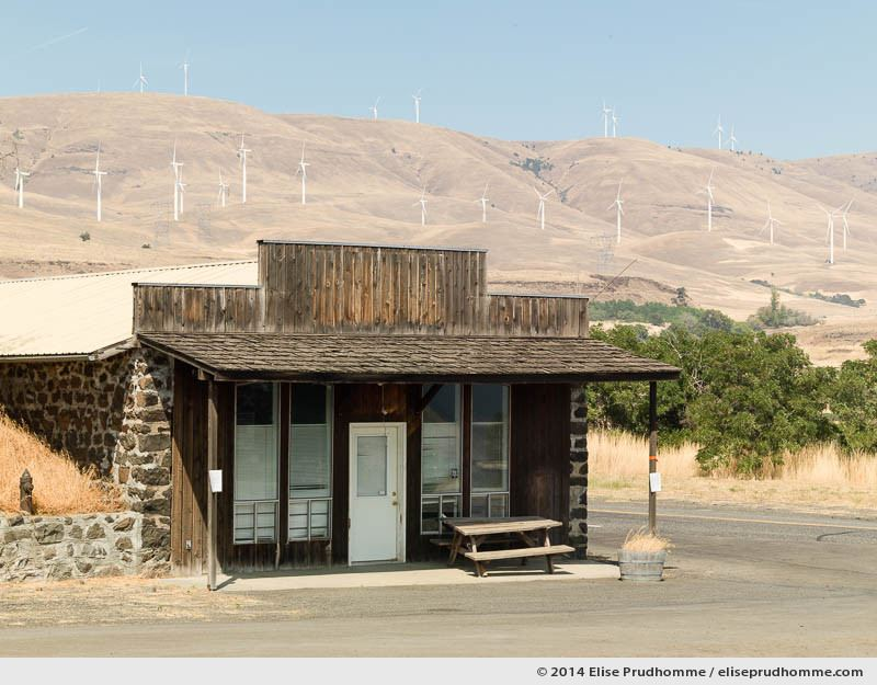 Wind farm and country store, Stonehenge Memorial, Maryhill, Washington, USA, 2014 (series Wild Wild West) by Elise Prudhomme.