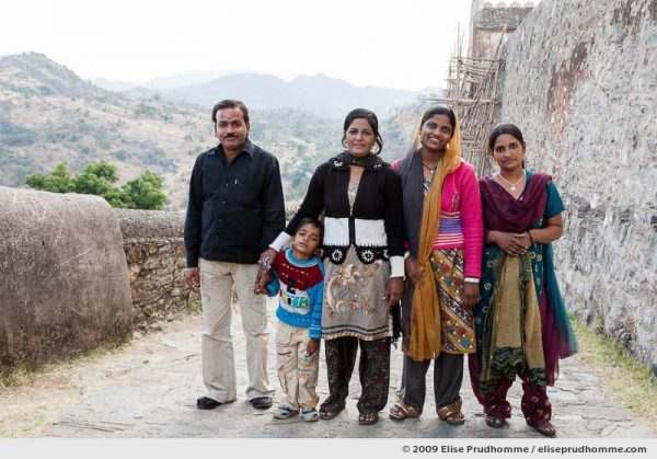 An Indian family posing for a portrait while visiting Kumbalgarh Fort, India, Rajasthan, Northern India, 2009 by Elise Prudhomme.