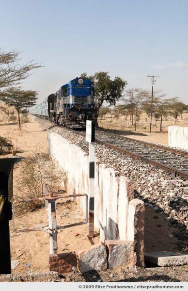 Approaching train at rural crossing near Jaisalmer, Rajasthan, India, 2009 by Elise Prudhomme.