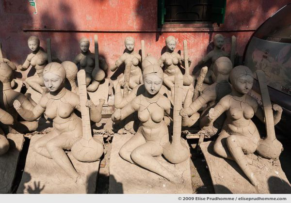 Partly-completed clay puja effigies of Goddess Saraswati in the Kumartuli district sculptor's enclave, Kolkata, Calcutta, West Bengal, India