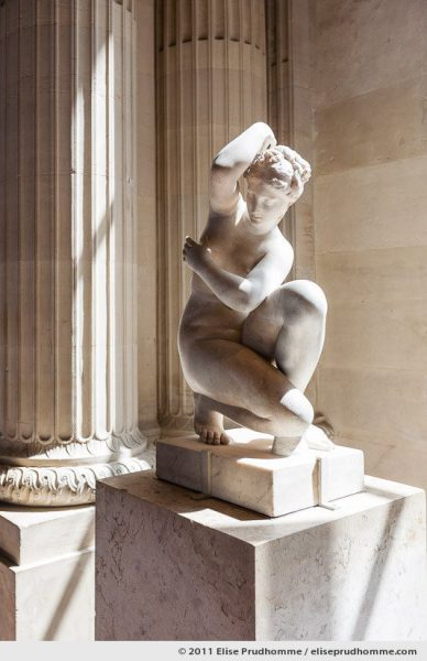 Crouching Venus by an unknown artist during I or II century A.D., at the Louvre Museum, Paris, France, 2011 by Elise Prudhomme.