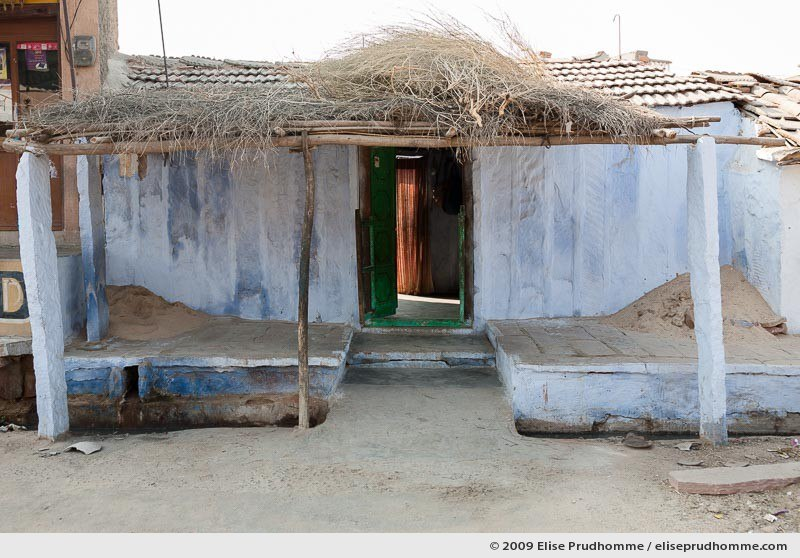 Simple porch and doorway entrance to a house in Rohet village, Rajasthan, Jodhpur, India, 2009 by Elise Prudhomme.
