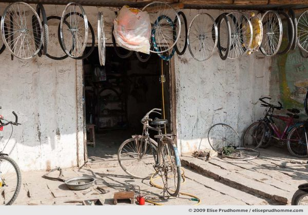 Facade of a bicycle repair shop in Rohet village, Rajasthan, Jodhpur, Northern India, 2009 by Elise Prudhomme.