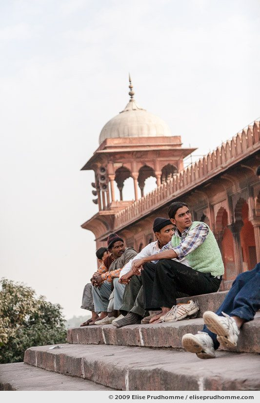 Four men waiting for prayer time at the steps of Jama Masjid, Old Delhi, India, 2009 by Elise Prudhomme.