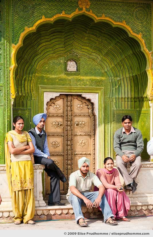 Indian family posing in front of the ornate peacock doorway, Chandra Mahal, Jaipur City Palace Complex, Rajasthan, India, 2009 by Elise Prudhomme.