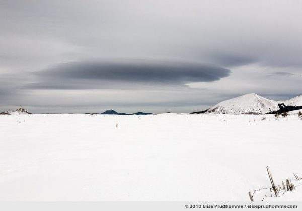 Lenticular cloud over the cross-country ski trail of the Banne d'Ordanche, Auvergne, France, 2010 by Elise Prudhomme.