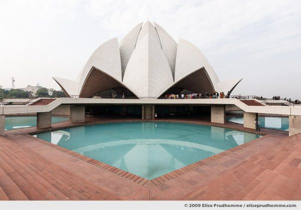 Lotus Temple and decorative pool under cloudy skies, New Delhi, India, 2009 by Elise Prudhomme.