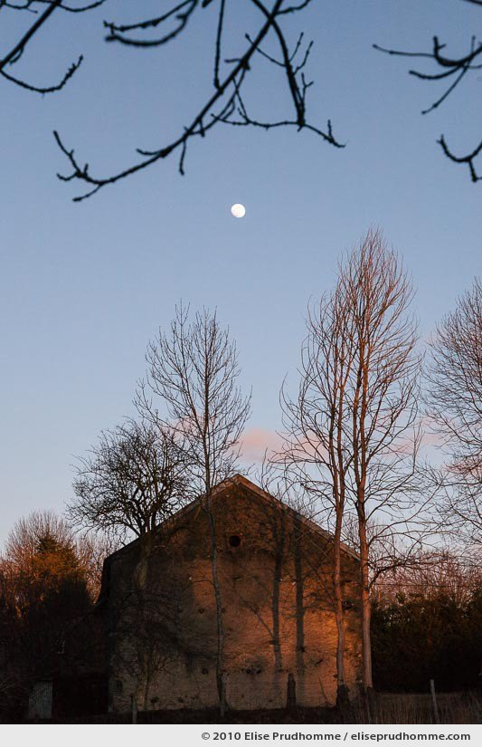 Moonrise over a farmhouse in the village of Saint-Ours-les-Roches, Auvergne, France, 2010 by Elise Prudhomme.