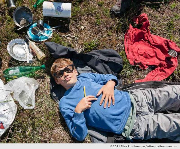 Overhead view of a young boy sleeping after a picnic, Fermanville, France, 2011 by Elise Prudhomme.