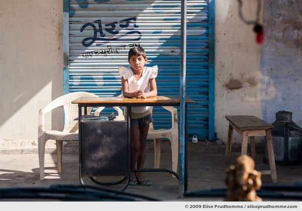 Portrait of an Indian girl in front of a shop in Abhaneri, Dausa, Rajasthan, India, 2009 by Elise Prudhomme.
