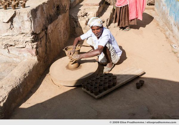 Potter making clay pots on a wheel, Abhaneri, Rajasthan, India, 2009 by Elise Prudhomme.