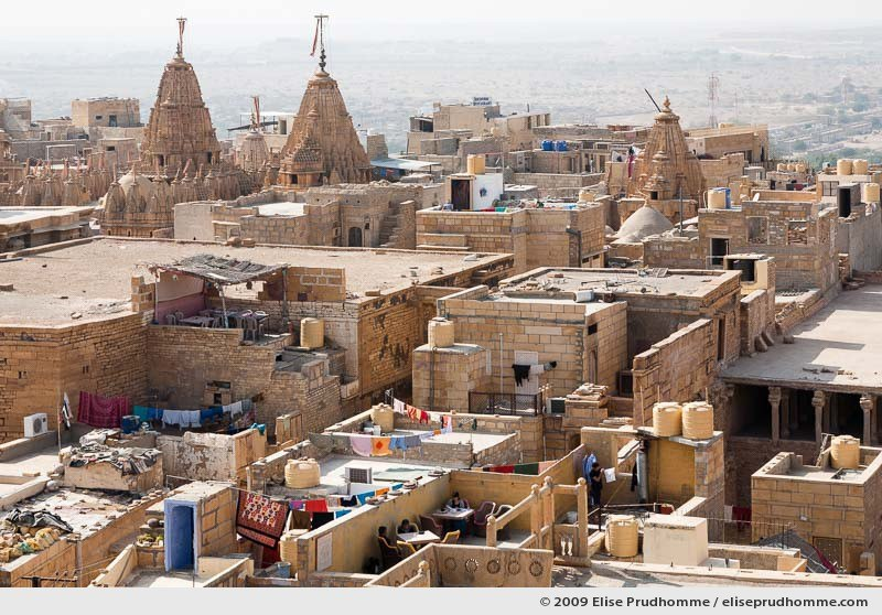 Rooftop view over Jaisalmer fortress with Jain temples in the distance, Western Rajasthan, India, 2009 by Elise Prudhomme