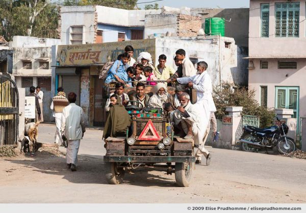 Rural agricultural workers on their way to work in an open truck, Rajasthan, India, 2009 by Elise Prudhomme.