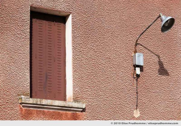 Rural village house window and street lamp detail, Beauregard, Saint-Ours-les-Roches, Auvergne, France, 2010 by Elise Prudhomme.