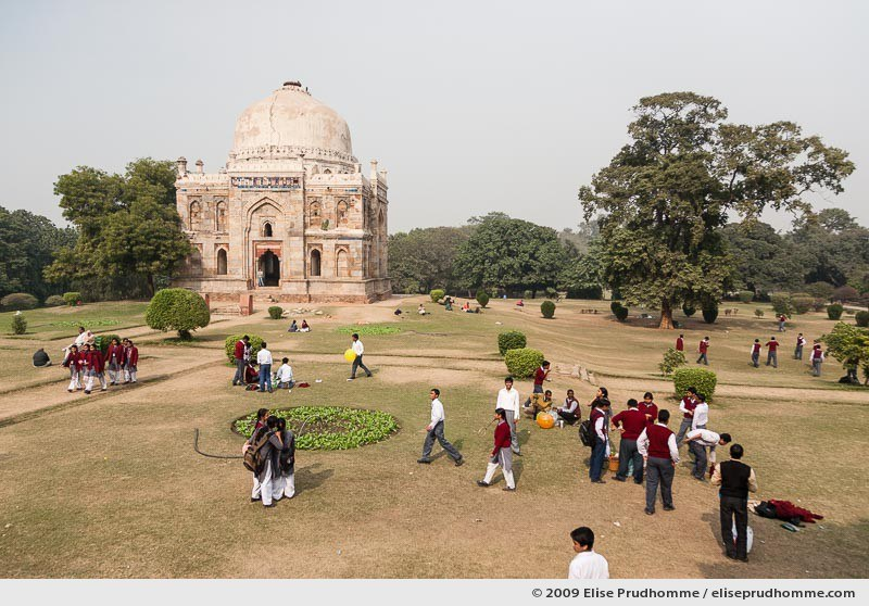 School students relaxing in front of Shisha Gumbad, Lodi Gardens, Delhi, India, 2009 by Elise Prudhomme