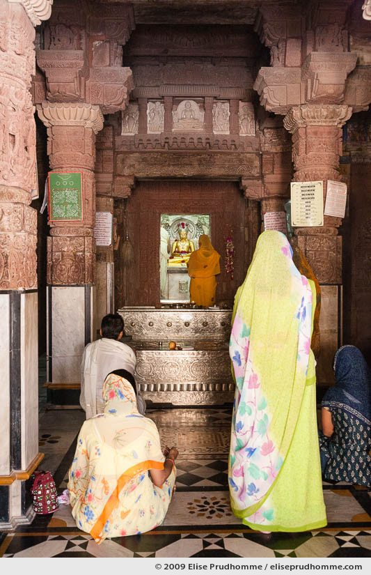 A shrine and worshippers inside Mahavira Jain Temple, Osian, near Jodhpur, Rajasthan, India, 2009 by Elise Prudhomme.