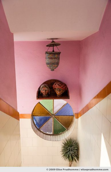 Staircase with color stained glass and sculpted heads, Jaipur, Rajasthan, India, 2009 by Elise Prudhomme.