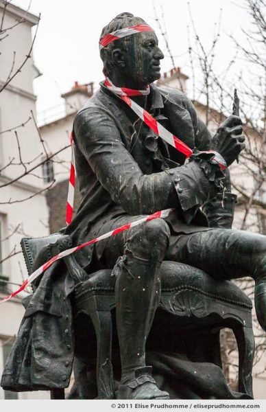 Statue of Denis Diderot by Jean Gautherin in red tape, Paris, France, 2011 by Elise Prudhomme.