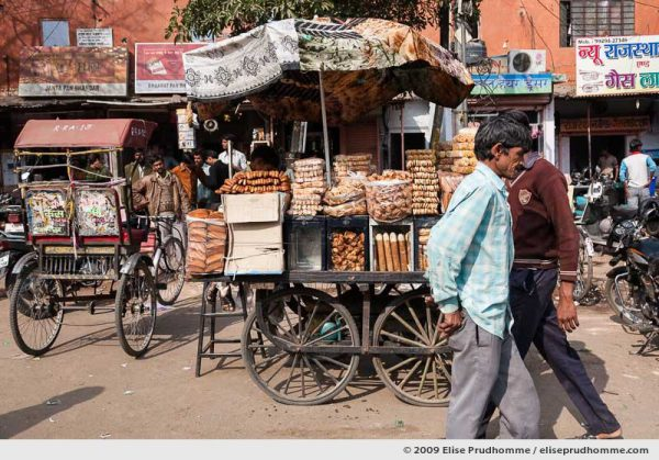 Daily street scene with street vendors selling bread in the old city of Jaipur, Rajasthan, India, 2009 by Elise Prudhomme.