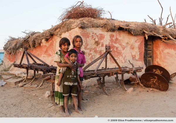 Three children at sunset in Hindu Brahman high caste village of Dhudaly, Rajasthan, Northern India, 2009 by Elise Prudhomme.