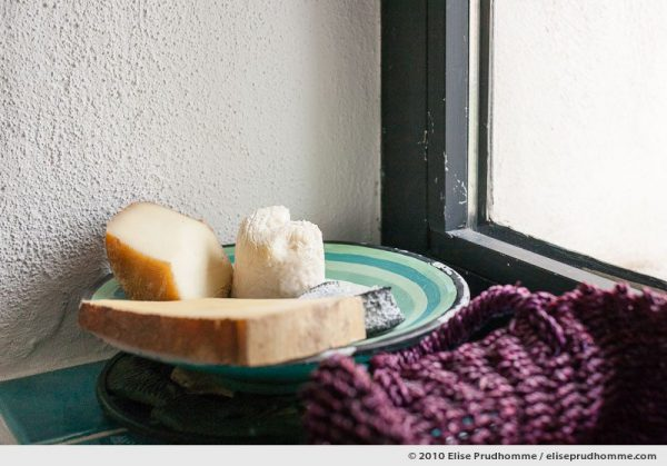 Three different types of French cheeses on a plate in the windowsill, Arzac, France, 2010 by Elise Prudhomme.