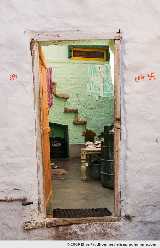 Traditionally painted mud wall and doorway of a home in the fort of Jaisalmer, Rajasthan, Western India, 2009 by Elise Prudhomme.