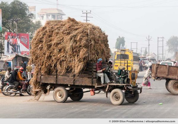 Truck overloaded with straw on the Agra Road, Uttar Pradesh, India, 2010 by Elise Prudhomme.