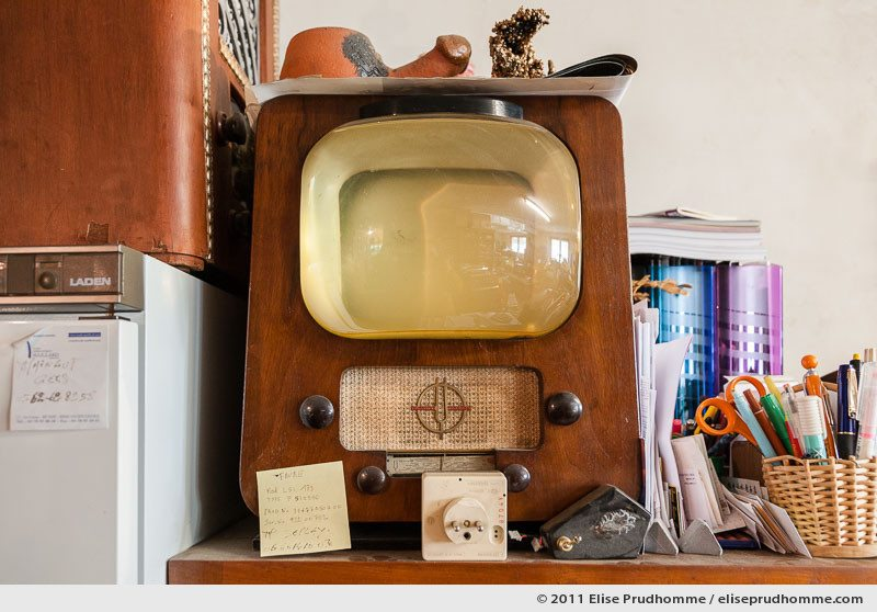Vintage television set and other paraphernalia on a storage shelf, Clermont-Ferrand, France, 2011 by Elise Prudhomme.