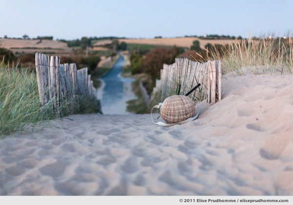 Sunset on a wicker fishing basket left on a beach path, Montmartin-sur-Mer, France, 2011 by Elise Prudhomme.
