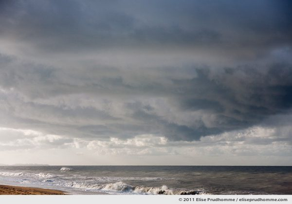 Winter seascape with Granville in the distance, Havre de la Vanlée, France, 2011 by Elise Prudhomme.