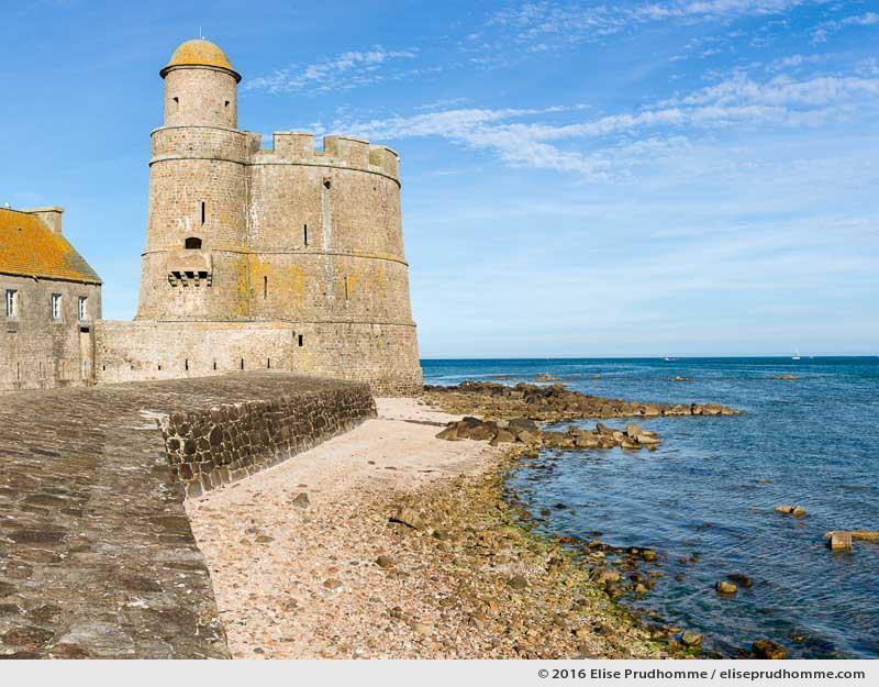 Fortified Vauban tower and English Channel during a waning tide, Tatihou Island, Saint-Vaast-la-Hougue, France