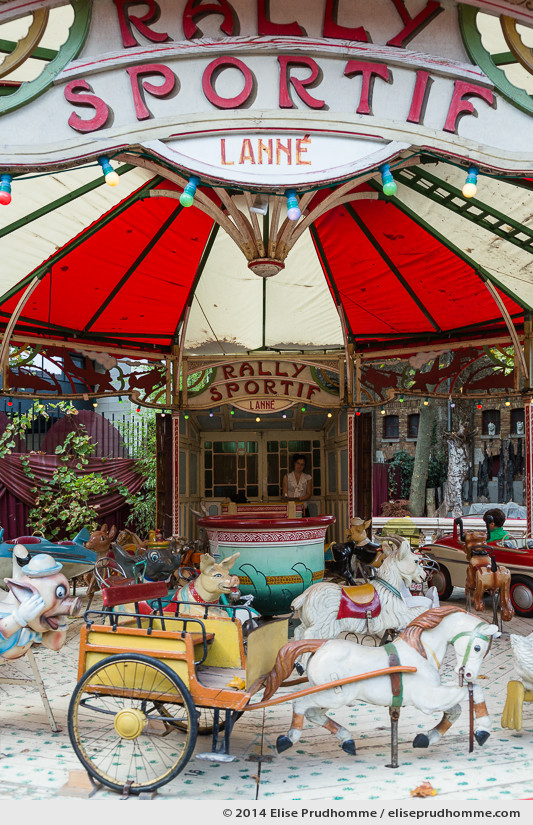 Vertical view of an ancient Merry-Go-Round Rally Sportif Lanné at the Museum of Fairground Arts in Paris, France.