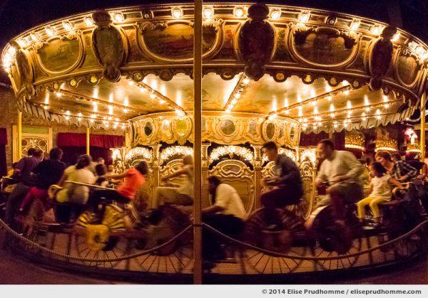 The 1885 Velocipedes peddle-powered Merry-Go-Round, Museum of Fairground Arts, Paris, France.  L'exceptionnel Manège de Vélocipèdes datant du 1885 au Musée des Arts Forains à Paris, France.