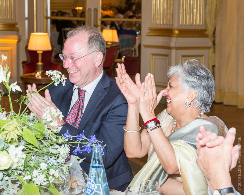 Guests cheering the bride's speech during the wedding reception at the Cercle de l'Union Interalliée, Paris, France.