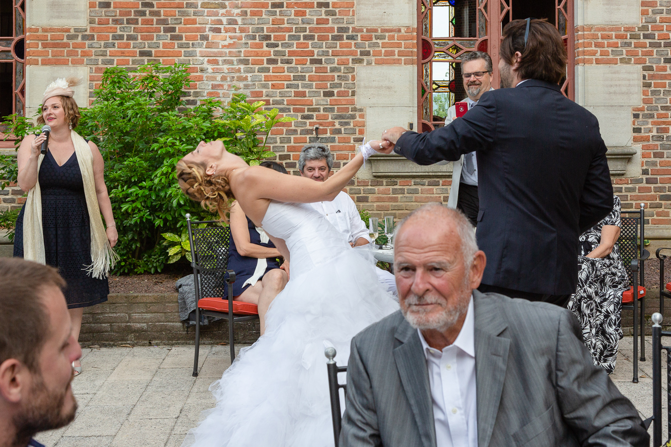 The bride strikes a pose during the entrance waltz with the groom during their Wedding Party Chateau de Maulmont near Vichy, France.