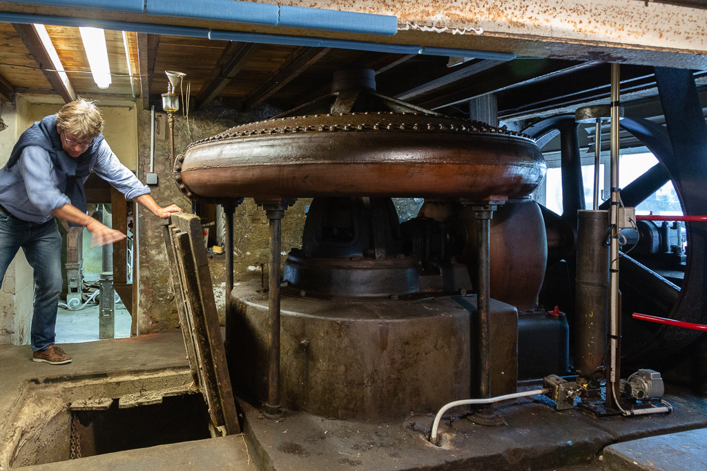 Benoit Lechevallier showing the hydraulic turbine engine of Saint Gabriel Flour Mill.   Restoration of the Saint-Gabriel Flour Mill, Saint-Gabriel-Brecy, France.
