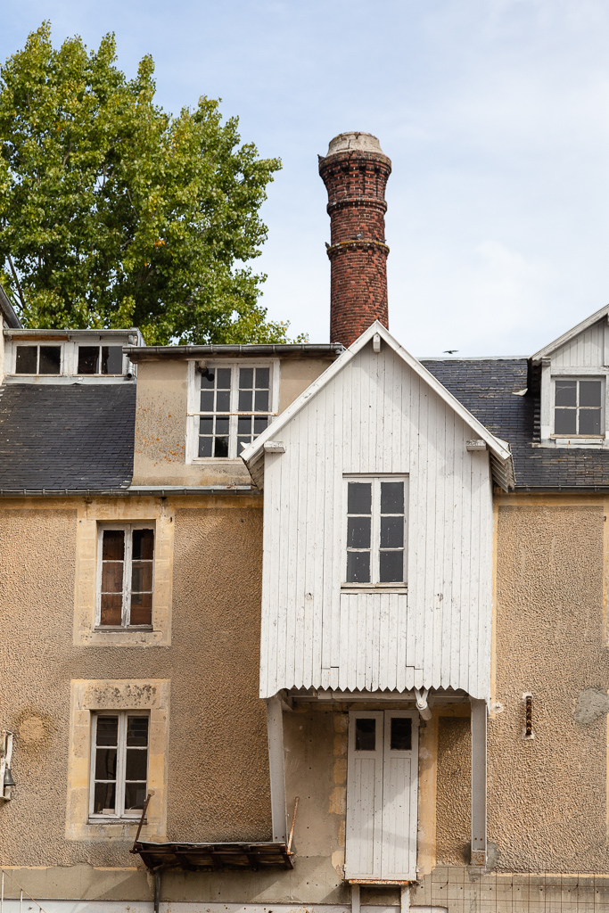 Exterior chimney and façade of the Saint Gabriel Flour Mill.  Restoration of the Saint-Gabriel Flour Mill, Saint-Gabriel-Brecy, France.