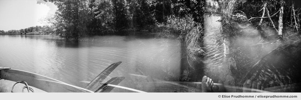 Black and white photograph of a rowboat on a lake in Buonconvento, Italy.  Analog photography series entitled Lieux-dits by Elise Prudhomme.