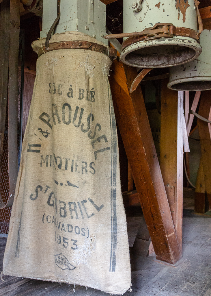 Sack of flour and shafts at the Saint Gabriel Mill.  Restoration of the Saint-Gabriel Flour Mill, Saint-Gabriel-Brecy, France.