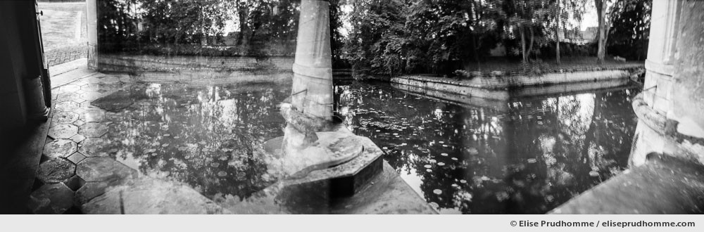 Black and white photograph of the moat and enivrons at Château de Tanlay, Burgundy, France.  Analog photography series entitled Lieux-dits by Elise Prudhomme.